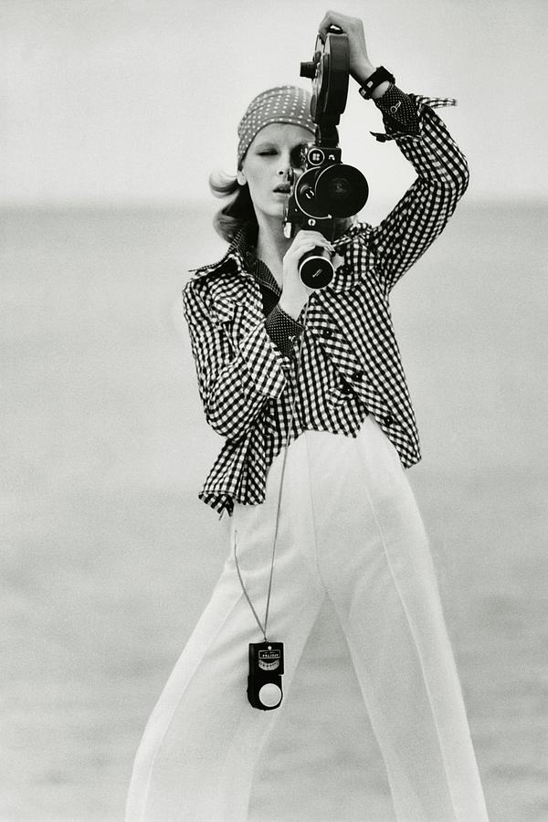 A Model Looking Through A Beaulieu Camera Wearing Photograph by Gianni Penati