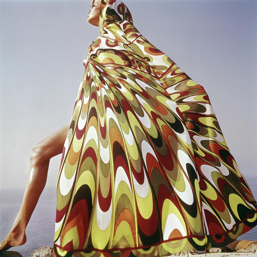 A Model Posing In A Colorful Cover-up Photograph by Henry Clarke