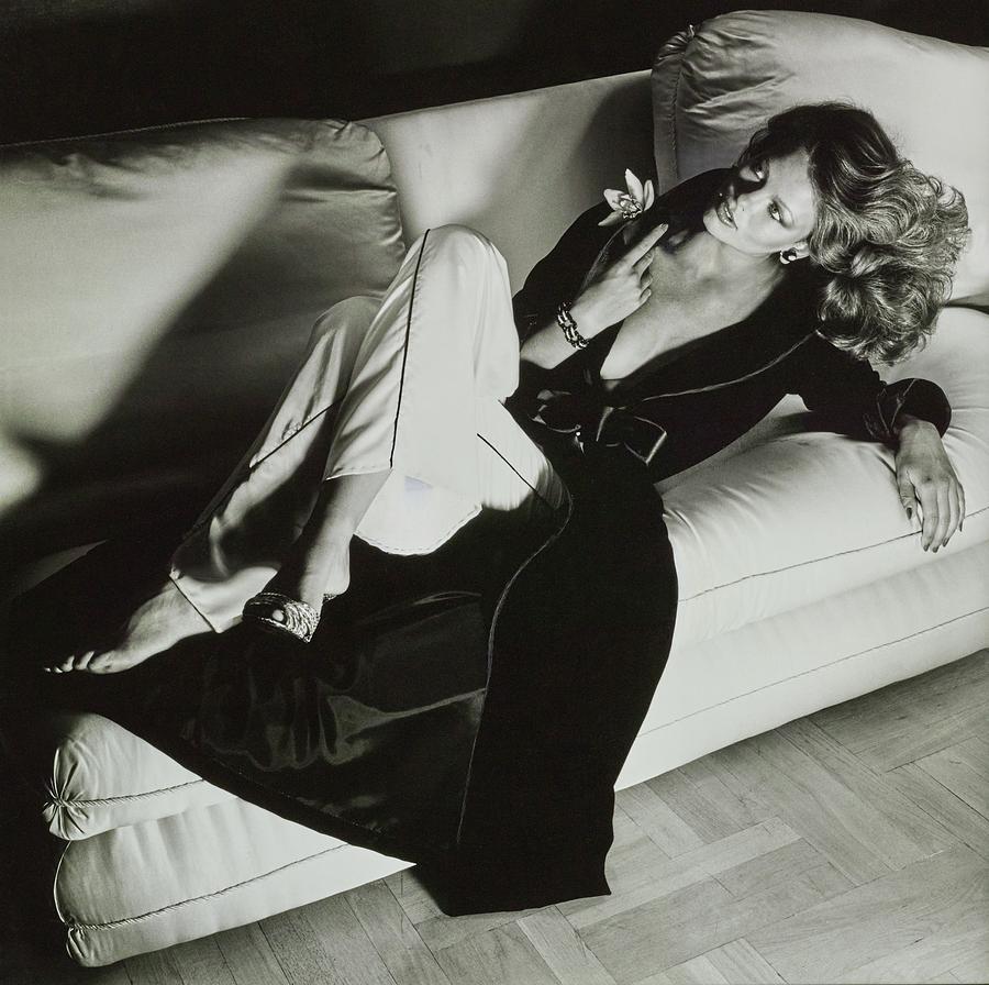 A Model Reclines On A Sofa Wearing Fernando Photograph by Chris von Wangenheim