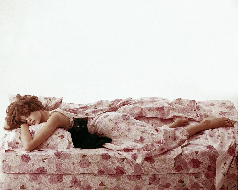 A Model Sleeping On Floral Bed Linens Photograph by Karen Radkai