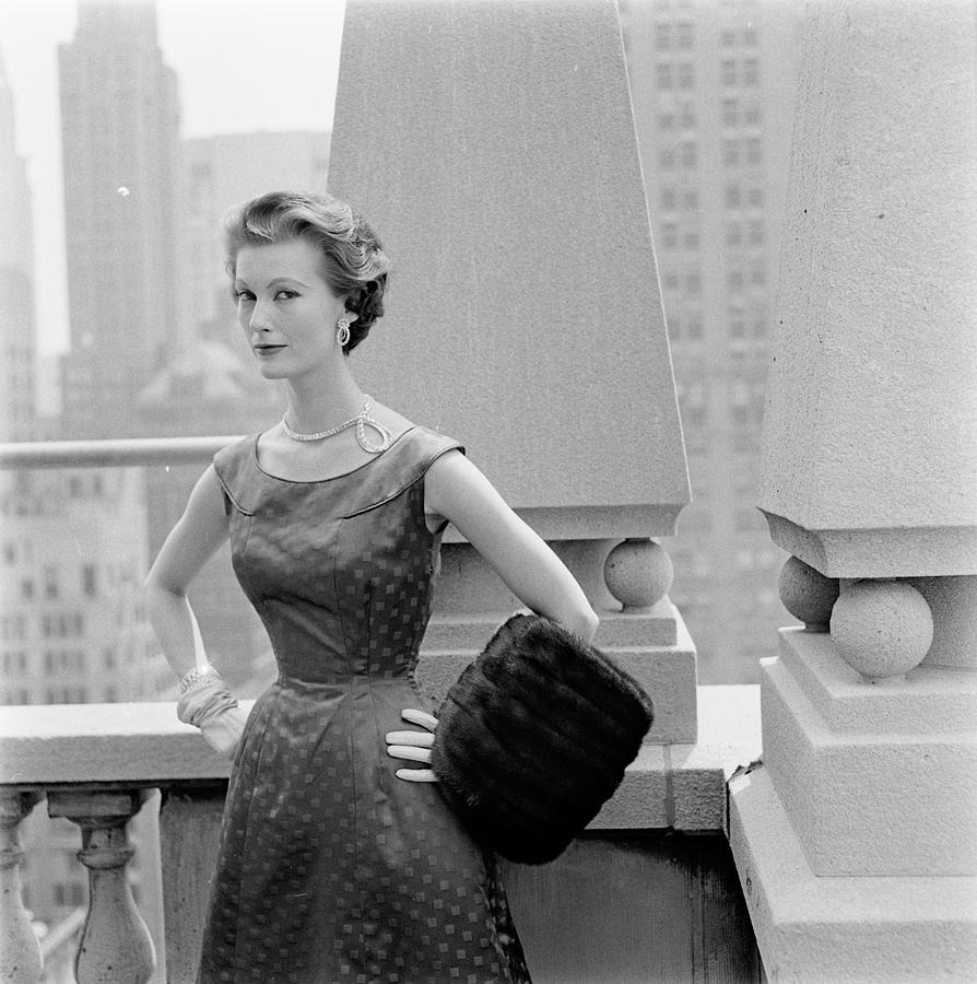 A Model Standing Against A Rooftop Column In An Photograph by Richard Rutledge