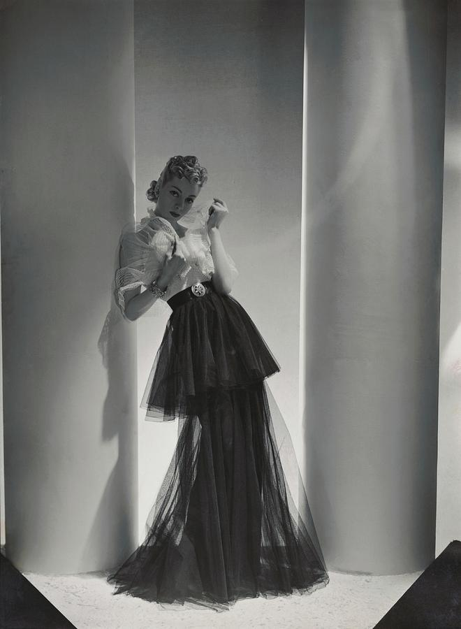 A Model Wearing A 1930s Style Evening Gown by Horst P. Horst