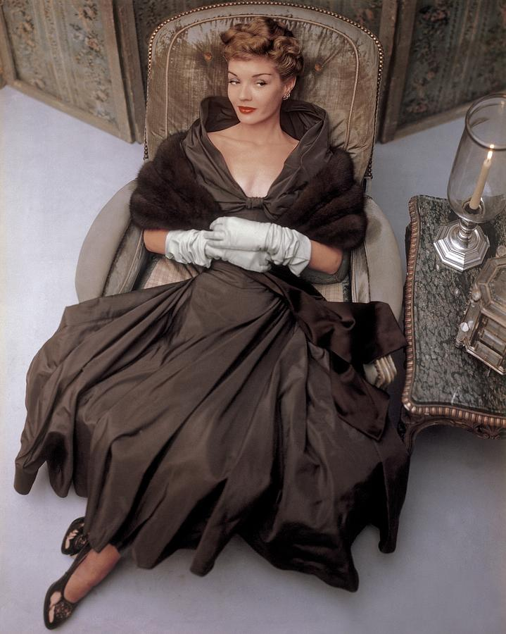 A Model Wearing A 1940s Style Evening Gown by John Rawlings