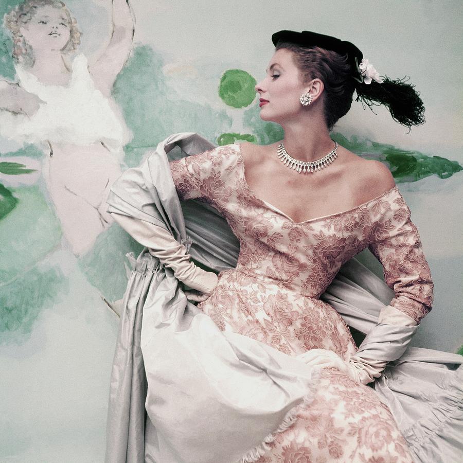 A Model Wearing A Balenciaga Dress Photograph by Henry Clarke