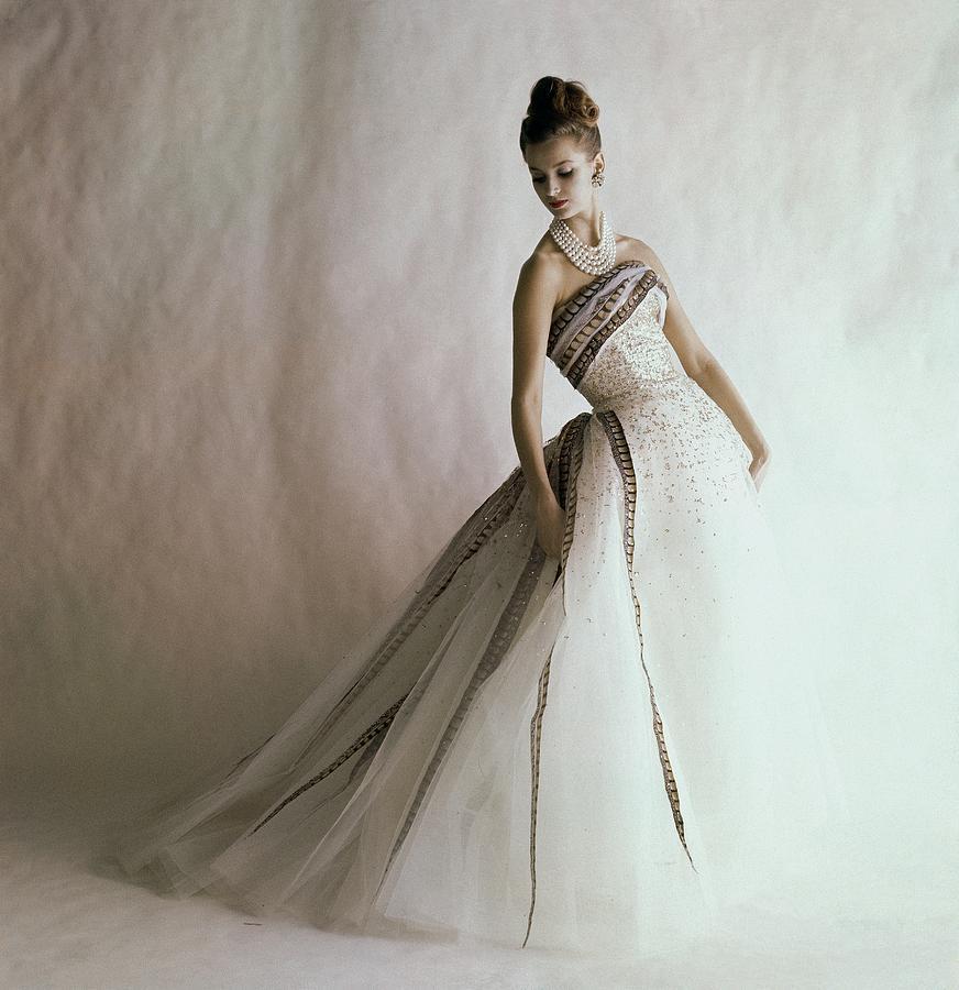 A Model Wearing A Balmain Dress Photograph by Jerry Schatzberg
