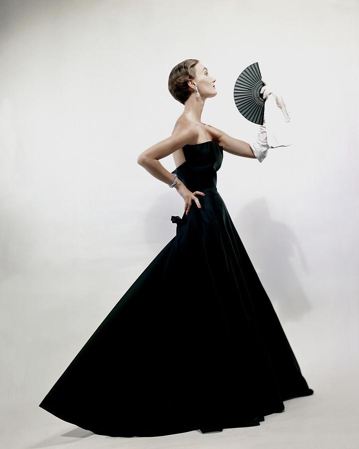 A Model Wearing A Christian Dior Dress Photograph by Erwin Blumenfeld
