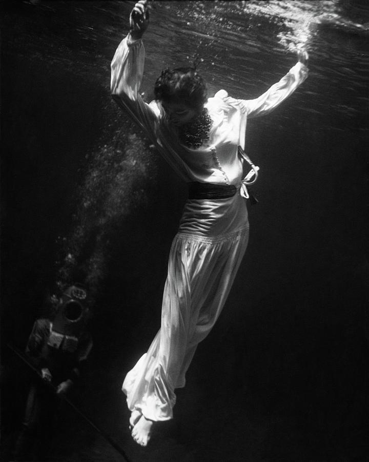 A Model Wearing A Dress Underwater Photograph by Toni Frissell