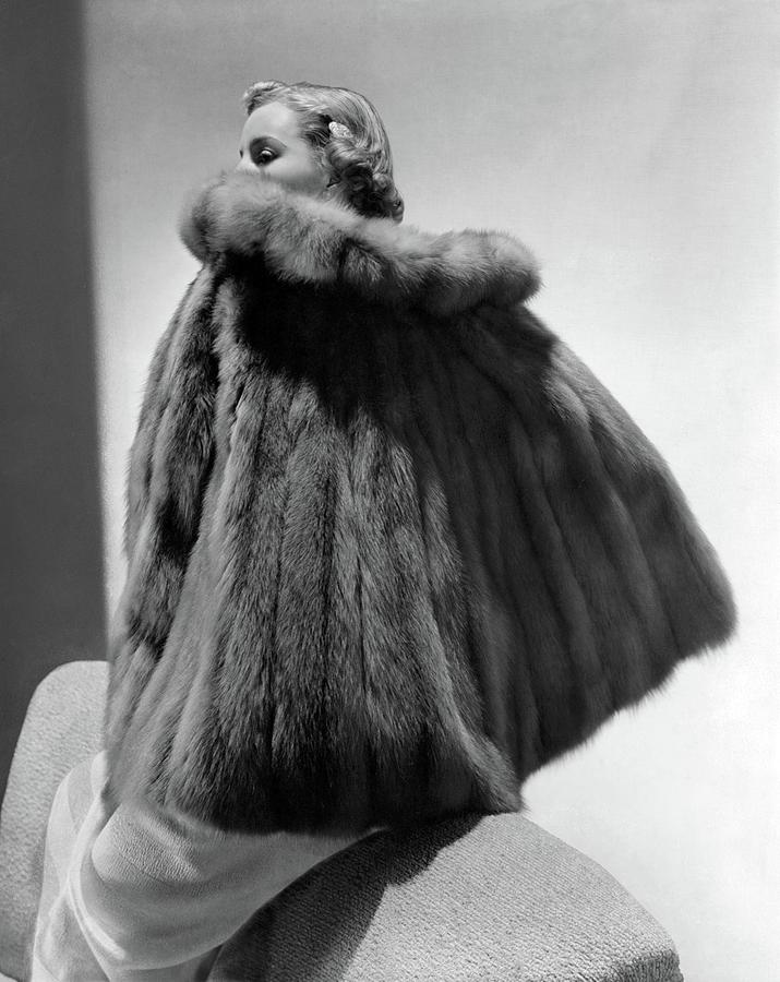 A Model Wearing A Fur Cape Photograph by Horst P. Horst