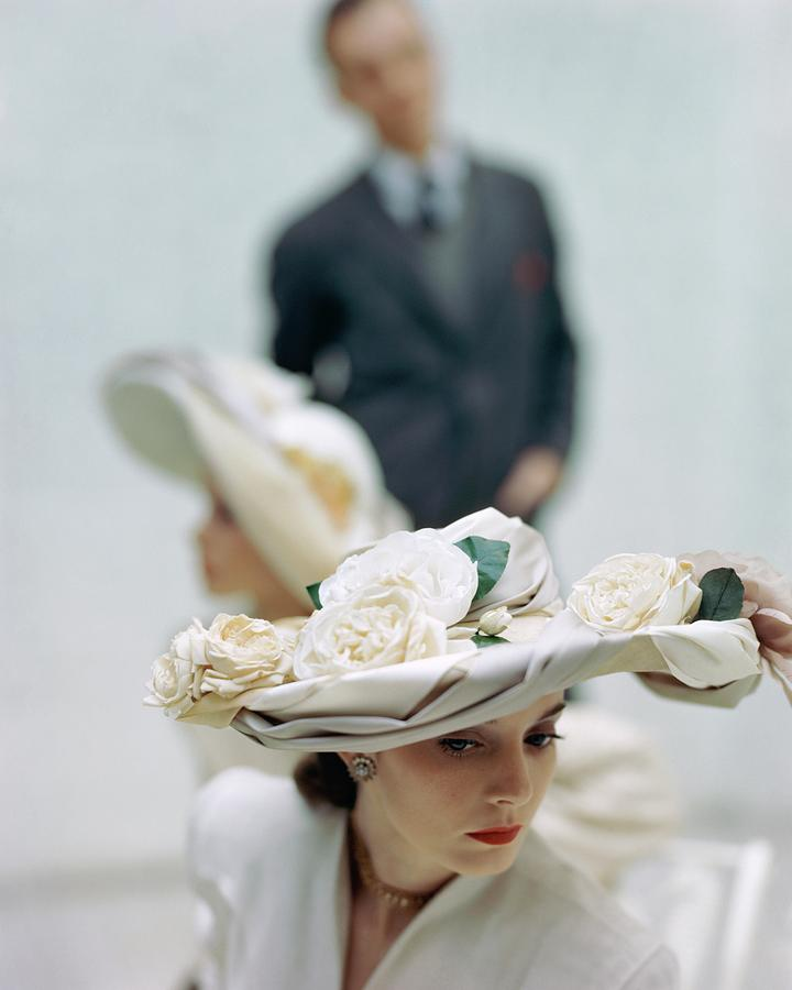 A Model Wearing A Hat Decorated With Flowers Photograph by John Rawlings