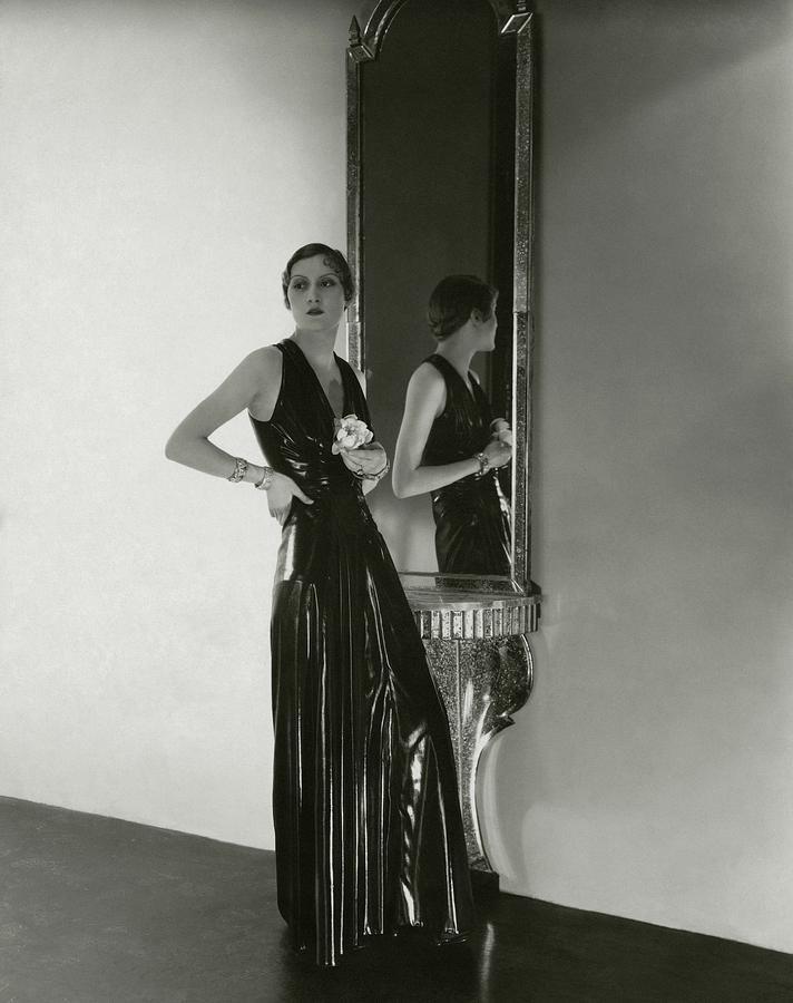A Model Wearing A Lezard Noir Dress Photograph by George Hoyningen-Huene