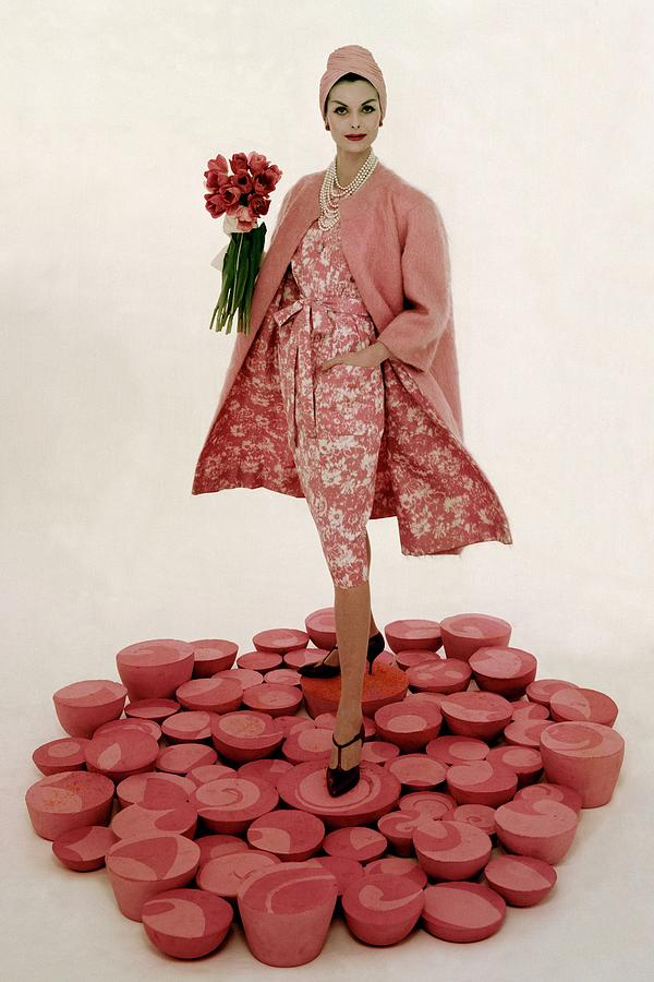 A Model Wearing A Matching Pink Outfit Holding Photograph by William Bell