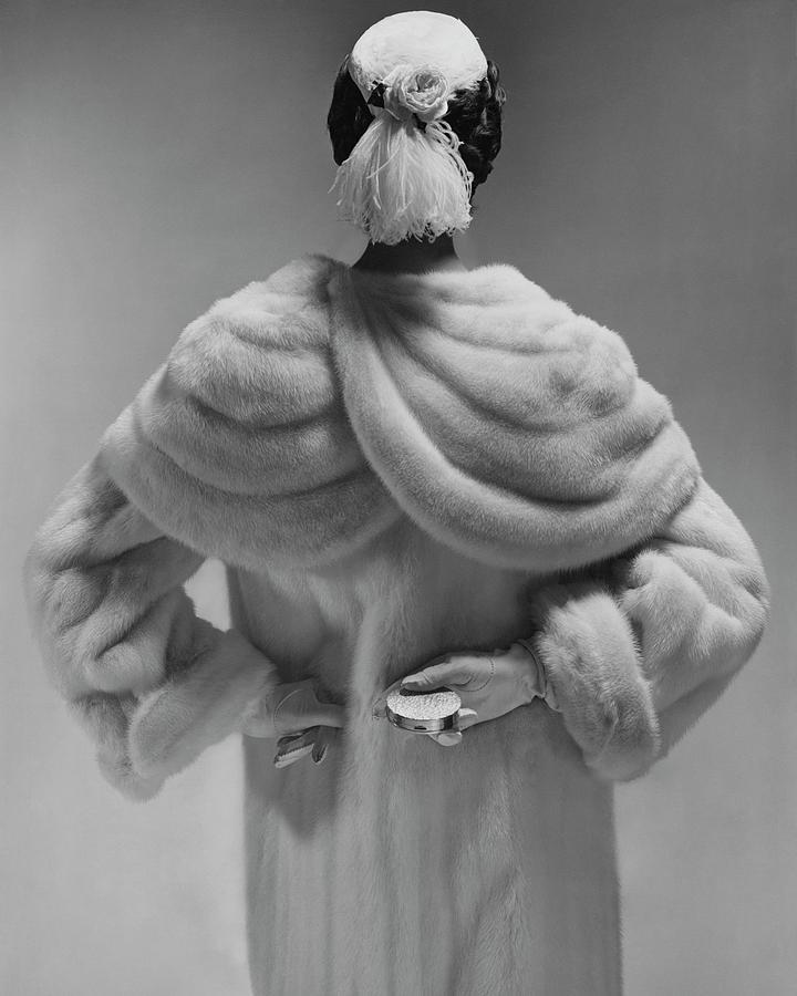 A Model Wearing A Mink Coat Photograph by Erwin Blumenfeld