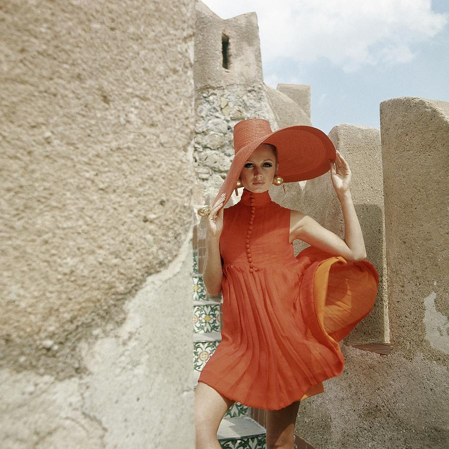 Fashion Photograph - A Model Wearing A Orange Dress by Henry Clarke