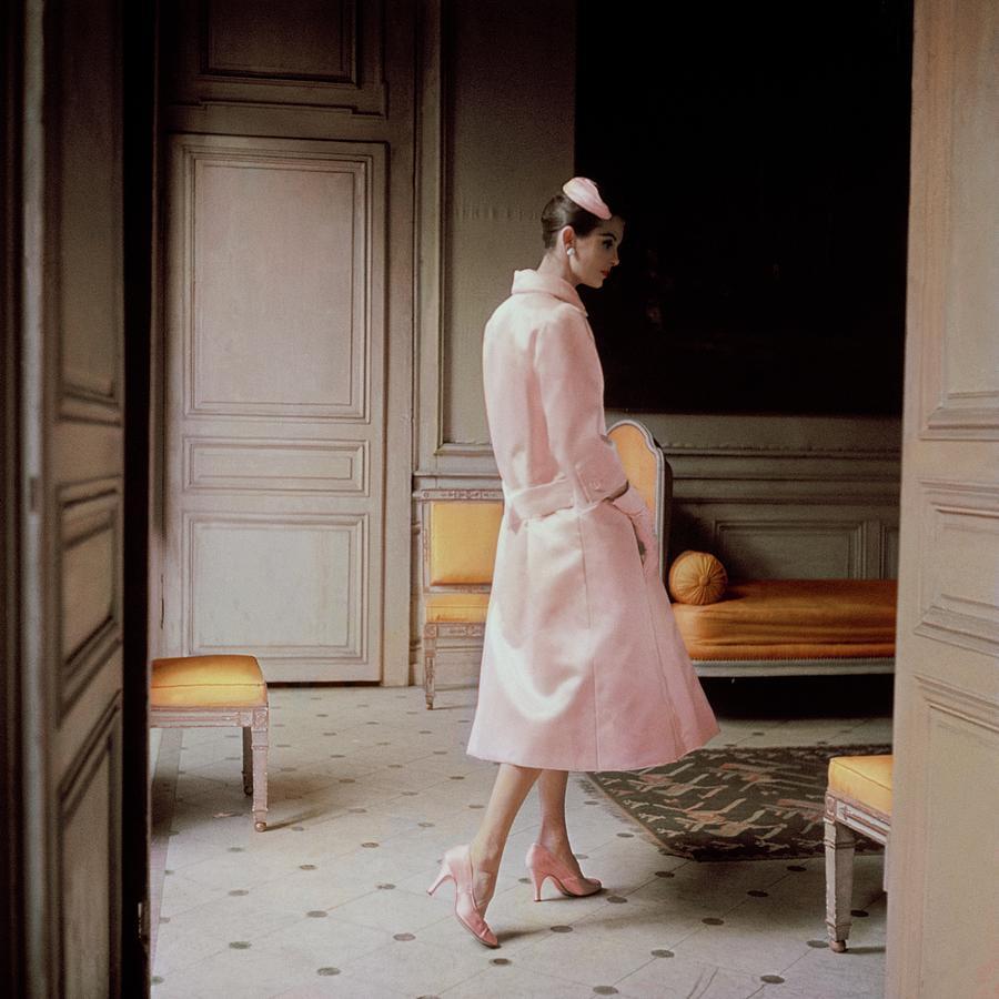 A Model Wearing A Pink Coat Photograph by Karen Radkai