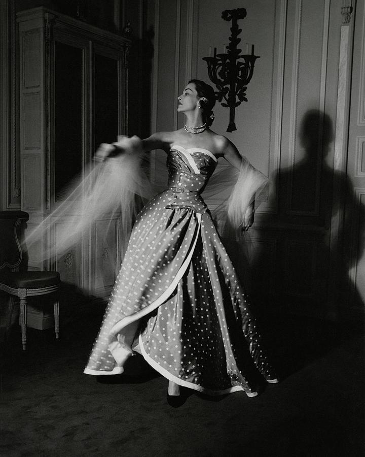 A Model Wearing A Polka Dot Dress Photograph by John Rawlings