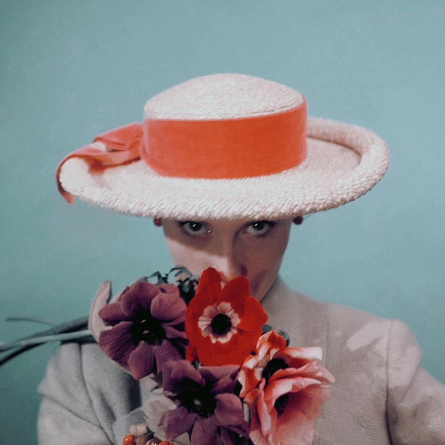 A Model Wearing A Straw Hat Photograph by Clifford Coffin