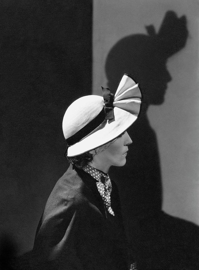 A Model Wearing A Straw Hat Photograph by George Hoyningen-Huene
