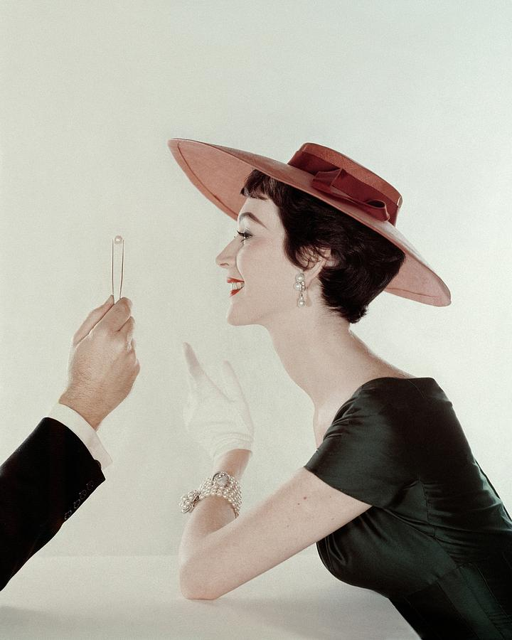 A Model Wearing A Sun Hat And Dress Photograph by John Rawlings