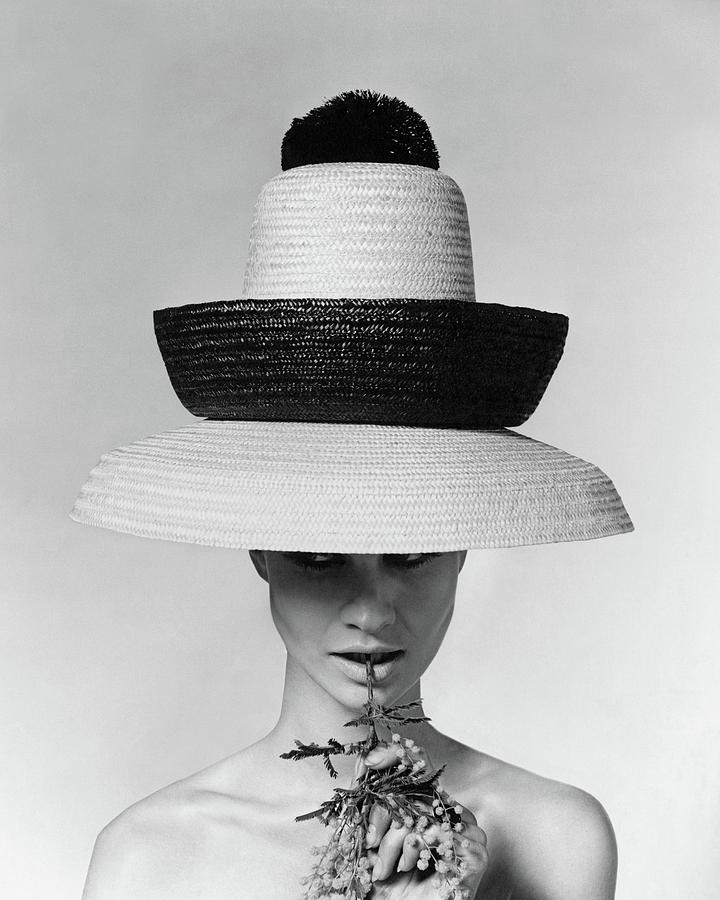 A Model Wearing A Sun Hat Photograph by Karen Radkai