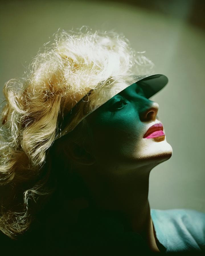 A Model Wearing A Sun Shade Photograph by Erwin Blumenfeld