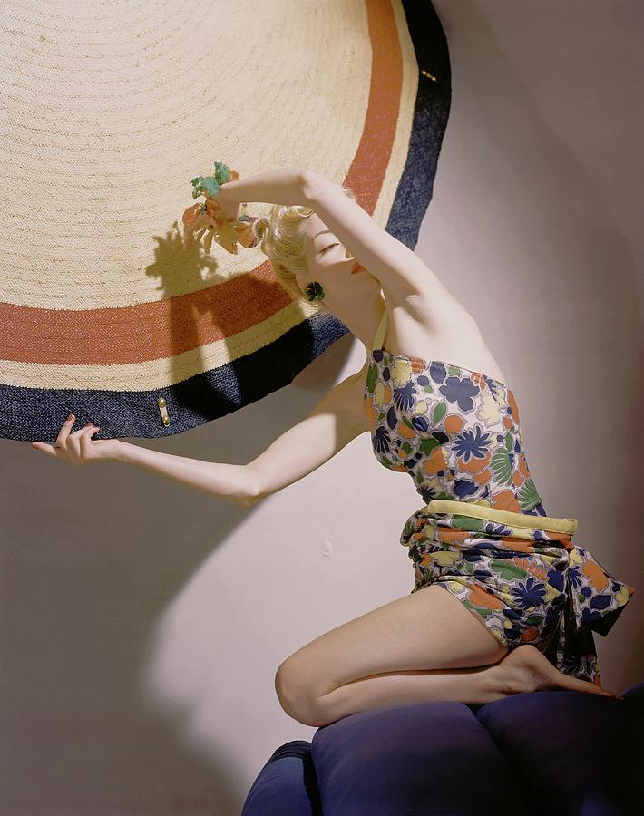 A Model Wearing A Swimsuit And Holding An Photograph by Horst P. Horst