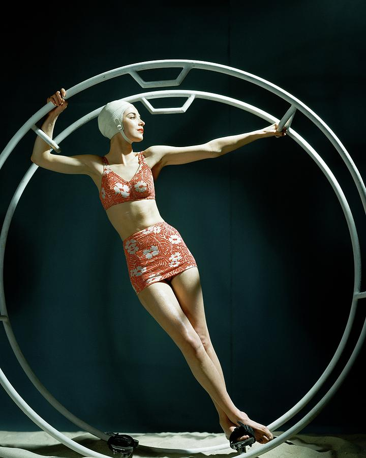 A Model Wearing A Swimsuit In An Exercise Ring Photograph by John Rawlings