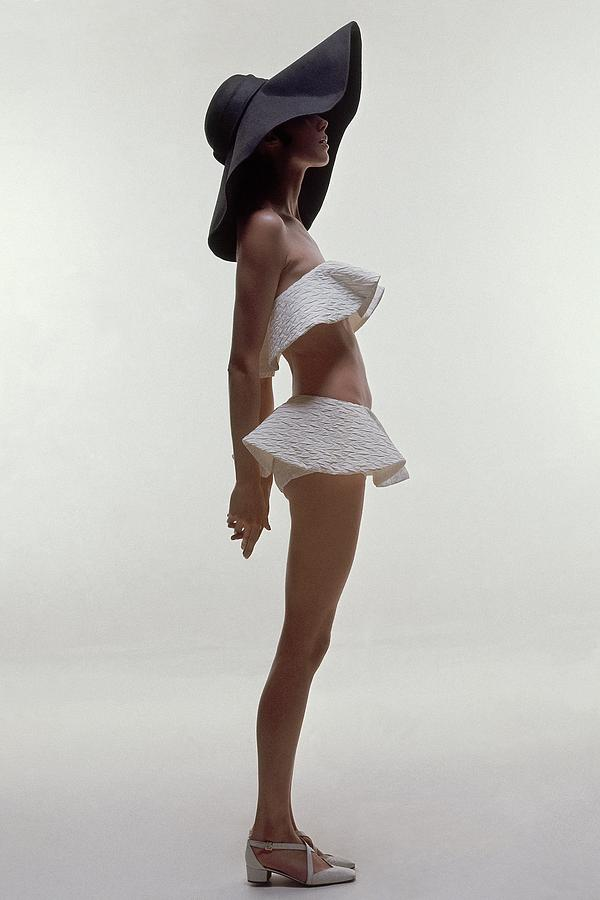 A Model Wearing A Two Piece Bathing Suit Photograph by Bert Stern