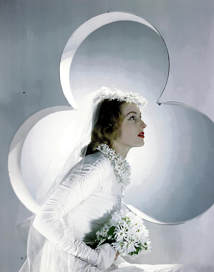 A Model Wearing A Wedding Gown Photograph by Horst P. Horst