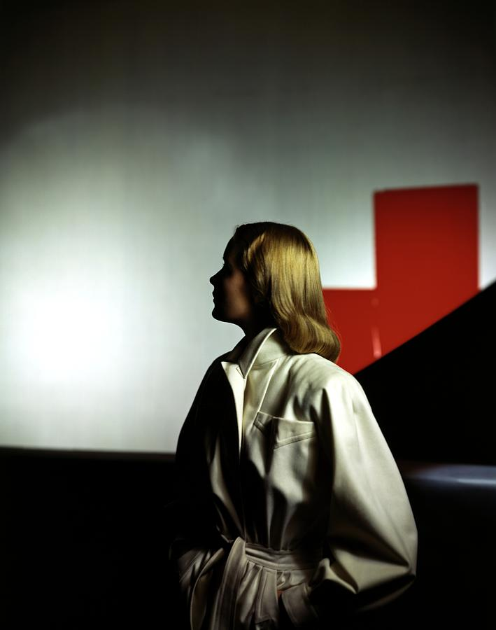 A Model Wearing A White Coat Photograph by Horst P. Horst