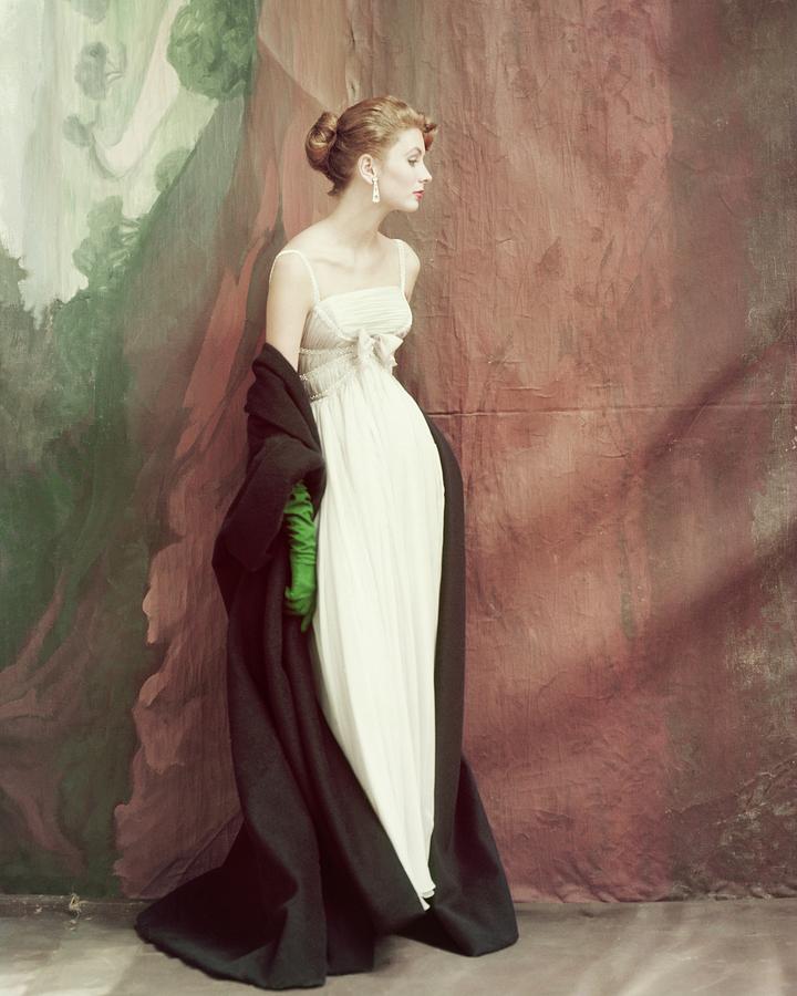 A Model Wearing A White Dress Photograph by John Rawlings