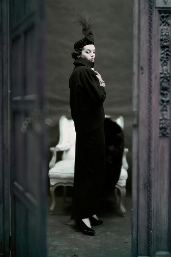 A Model Wearing An Adele Simpsons Ensemble Photograph by John Rawlings