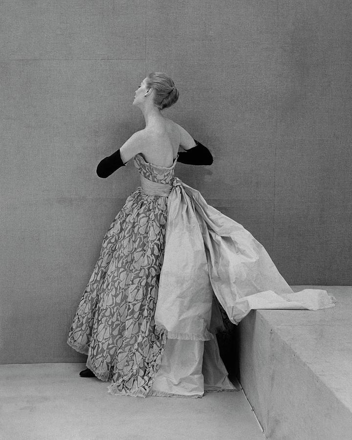 A Model Wearing An Evening Gown Photograph by Henry Clarke