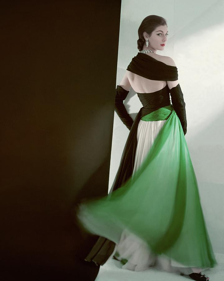 Fashion Photograph - A Model Wearing An Evening Gown by Horst P. Horst