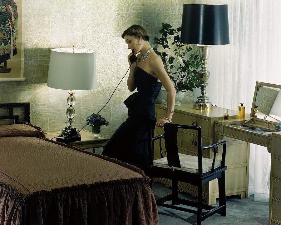 A Model Wearing An Evening Gown On The Telephone Photograph by Herbert Matter