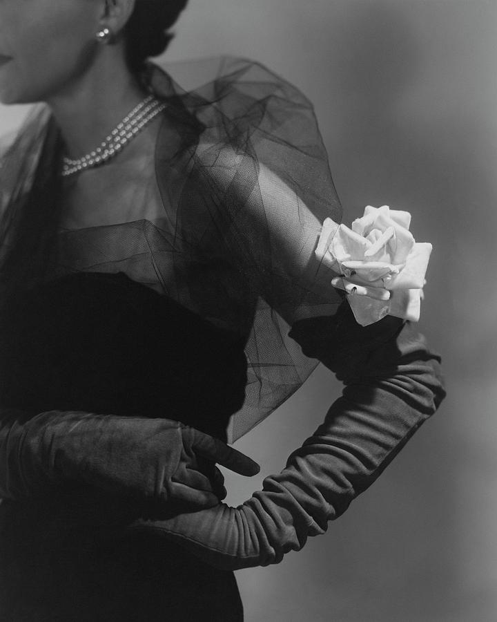 A Model Wearing And Velvet Rose Photograph by Horst P. Horst