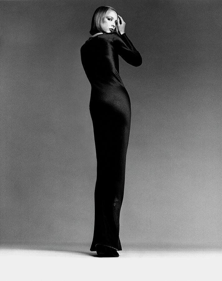 A Model Wearing Halston Photograph by Francesco Scavullo