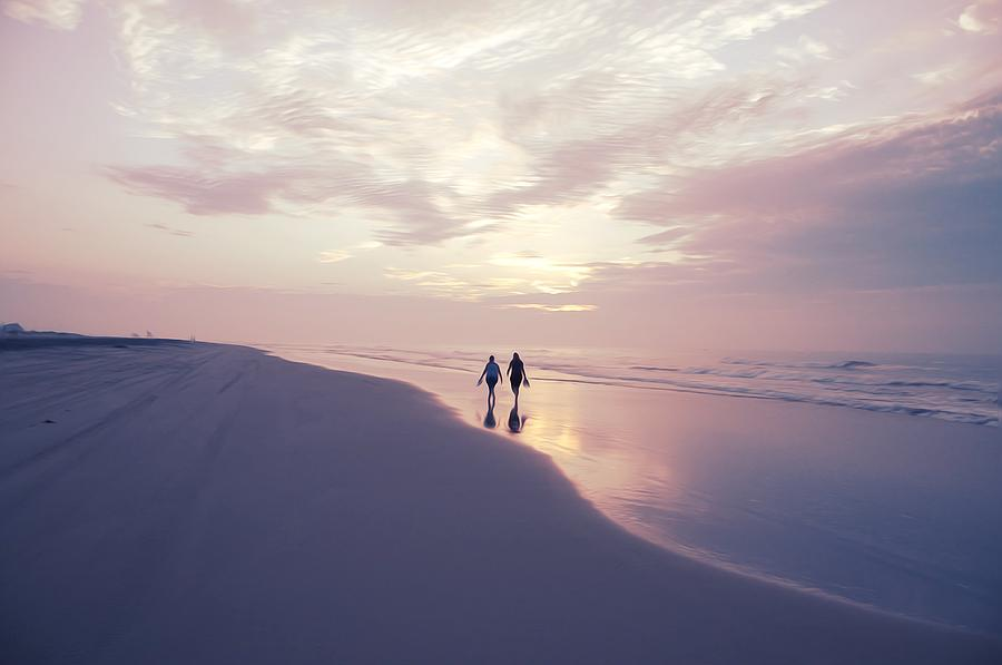 a morning walk on the beach photograph by bill cannon