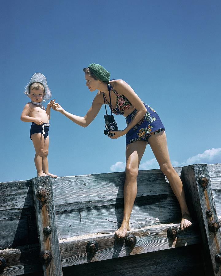 A Mother And Son On A Pier Photograph by Toni Frissell