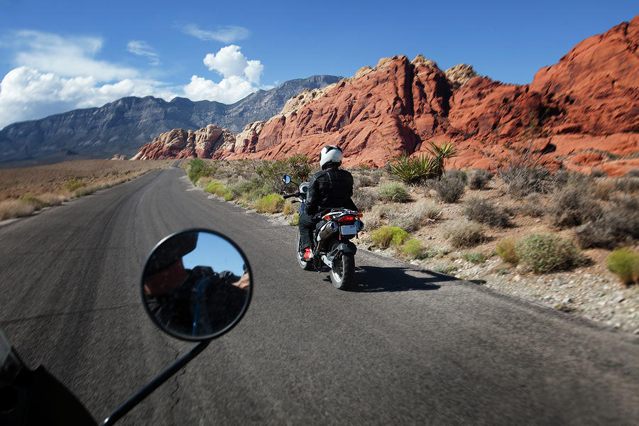 A Motorbike Rider In A Rocky Landscape Photograph by Russell Monk