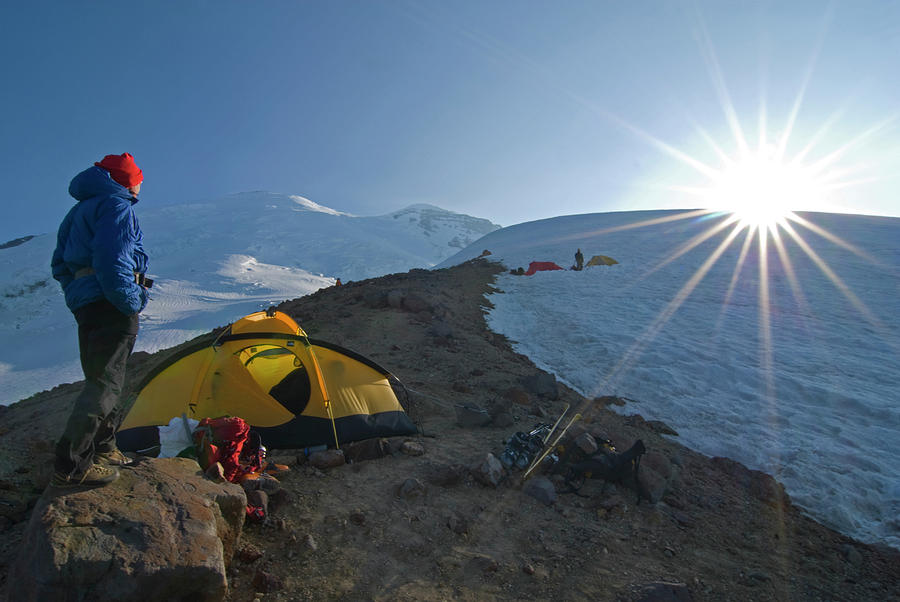Adult Photograph - A Mountaineer Contemplates The Sun by Cliff Leight