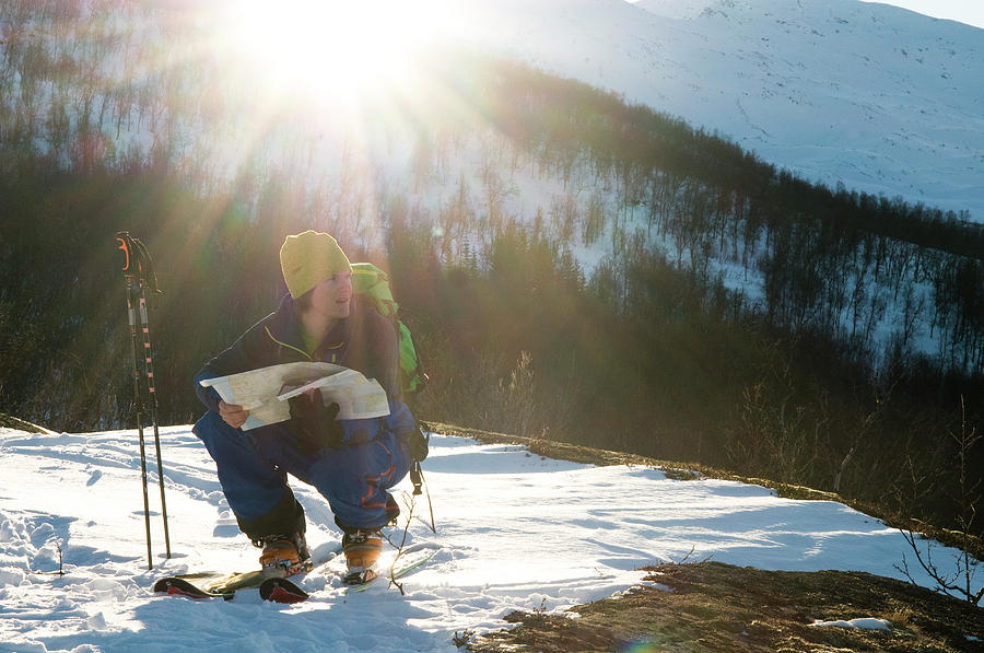 20s Photograph - A Norwegian Skier Examines A Map by Kari Medig