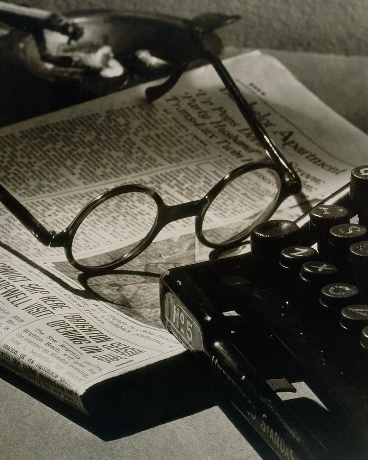 A Pair Of Glasses On Top Of A Newspaper Photograph by Irving Browning