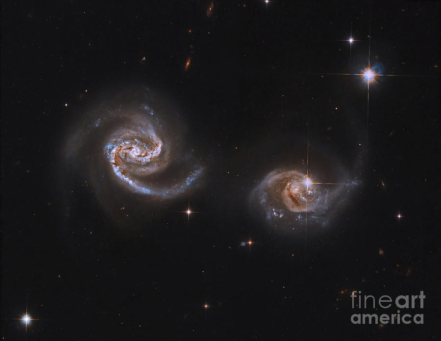 Horizontal Photograph - A Pair Of Interacting Spiral Galaxies by Roberto Colombari