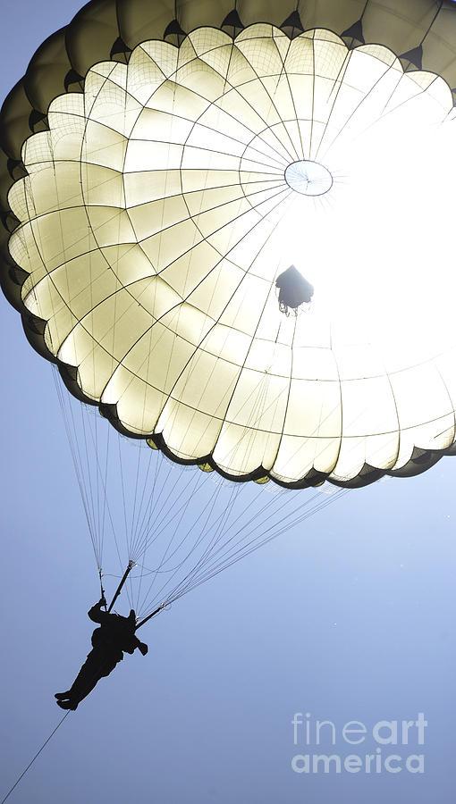 A Paratrooper Descends Onto The Drop Photograph