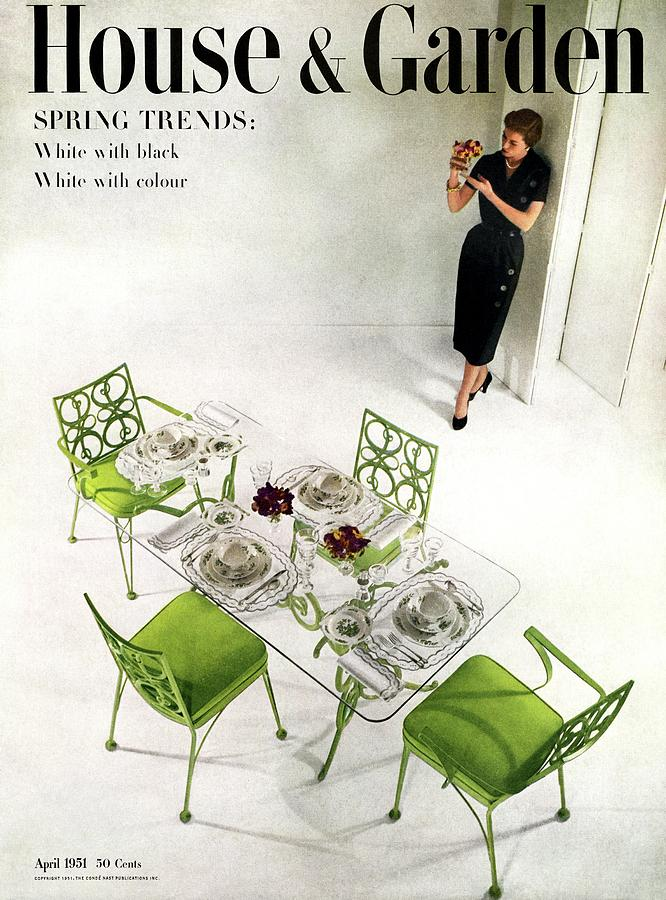 A Patio Table With A Model Standing Behind Photograph by Herbert Matter
