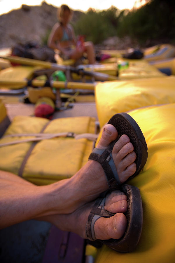 Action Photograph - A Persons Crossed Feet In Sandals by Corey Rich
