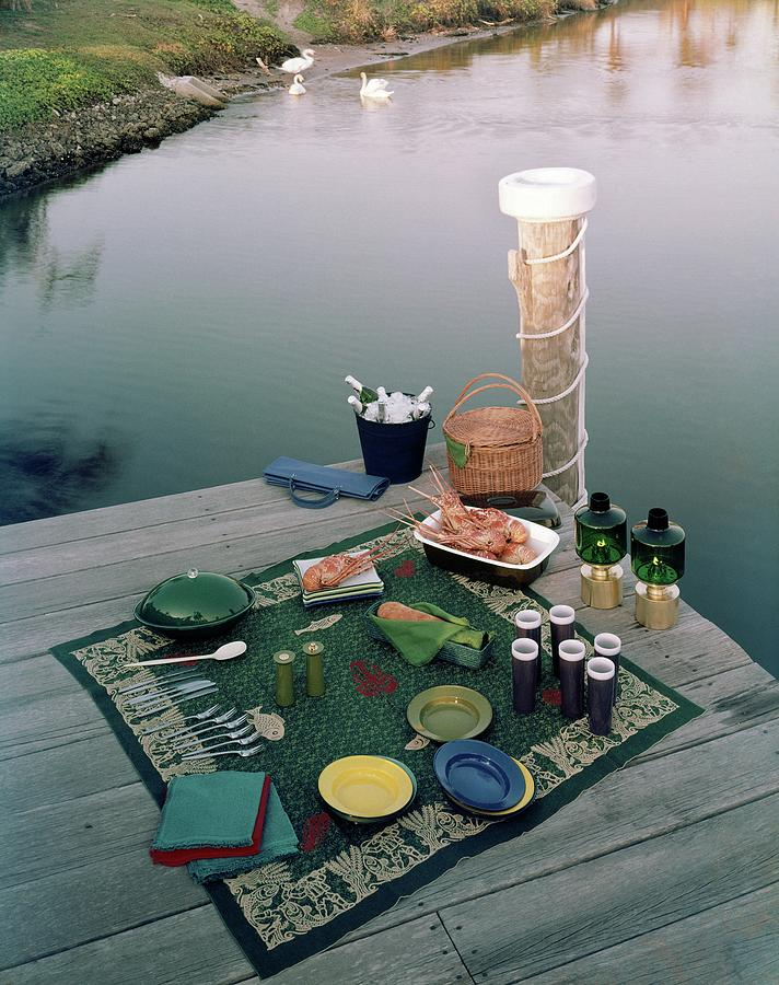 A Picnic Set Up On A Dock Photograph by Ernst Beadle