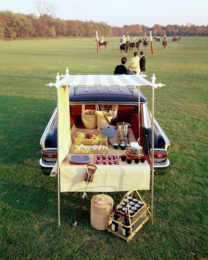 A Picnic Table Set Up On The Back Of A Car Photograph by Rudy Muller