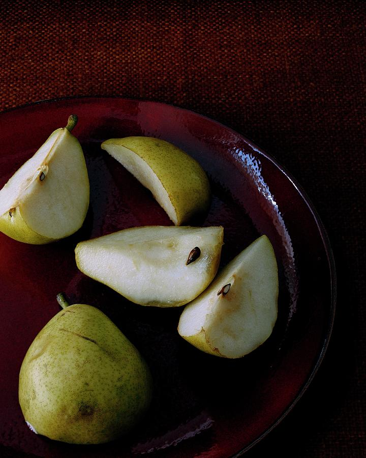 A Plate Of Pears Photograph by Romulo Yanes