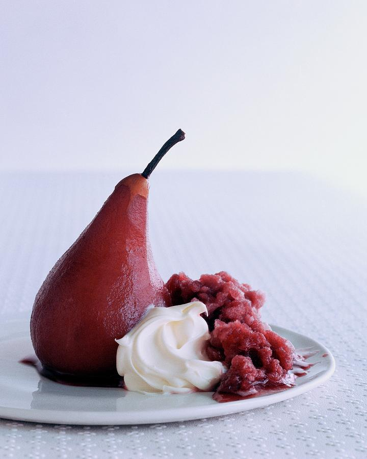 A Poached Pear With Cream Photograph by Romulo Yanes